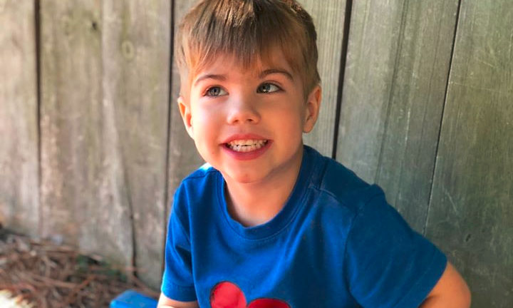 Smiling preschool boy wearing blue shirt with red heart shape in the middle at a Preschool & Daycare Serving Hampton Roads, VA