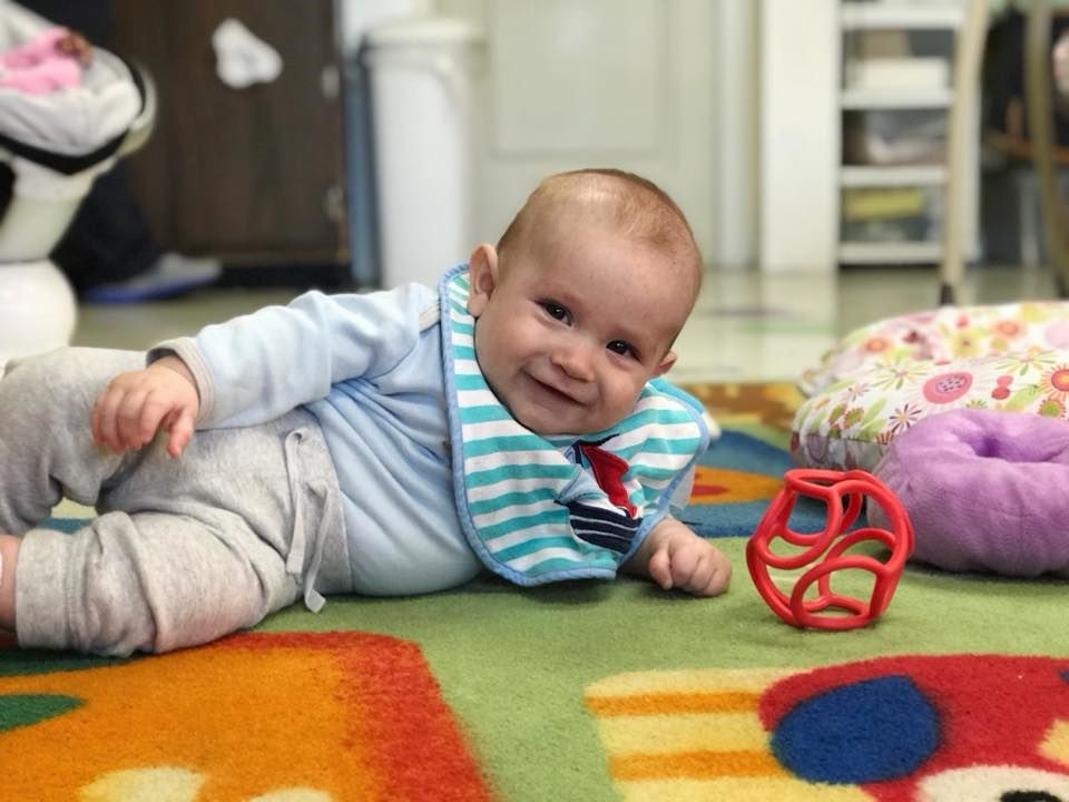 Smiling cute little baby boy at a Preschool & Daycare Serving Hampton Roads, VA