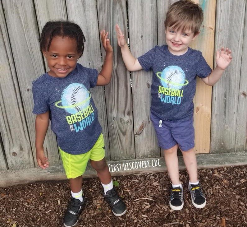 Preschool kids doing a high five and enjoy playing on their school yard at a Preschool & Daycare Serving Hampton Roads, VA