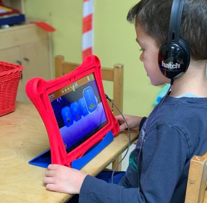 Preschooler getting advance lessons using their school tablet at a Preschool & Daycare Serving Hampton Roads, VA
