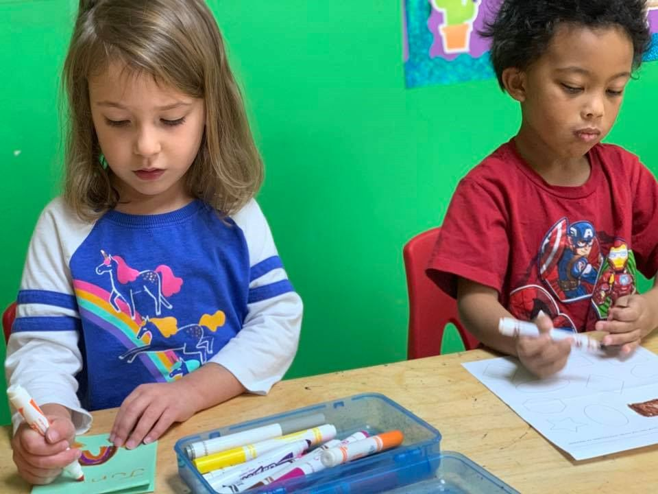 Preschoolers making a letter and writing a message for their parents on a school activity at a Preschool & Daycare Serving Hampton Roads, VA