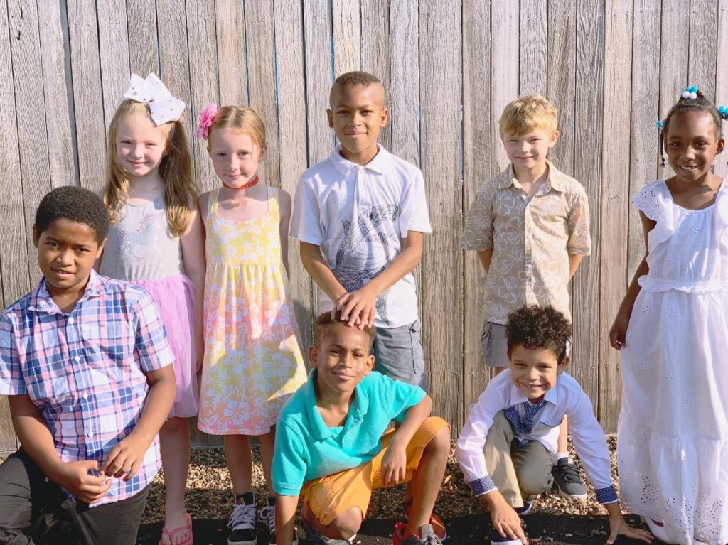 Group of happy kids posing on their school yard at a Preschool & Daycare Serving Hampton Roads, VA