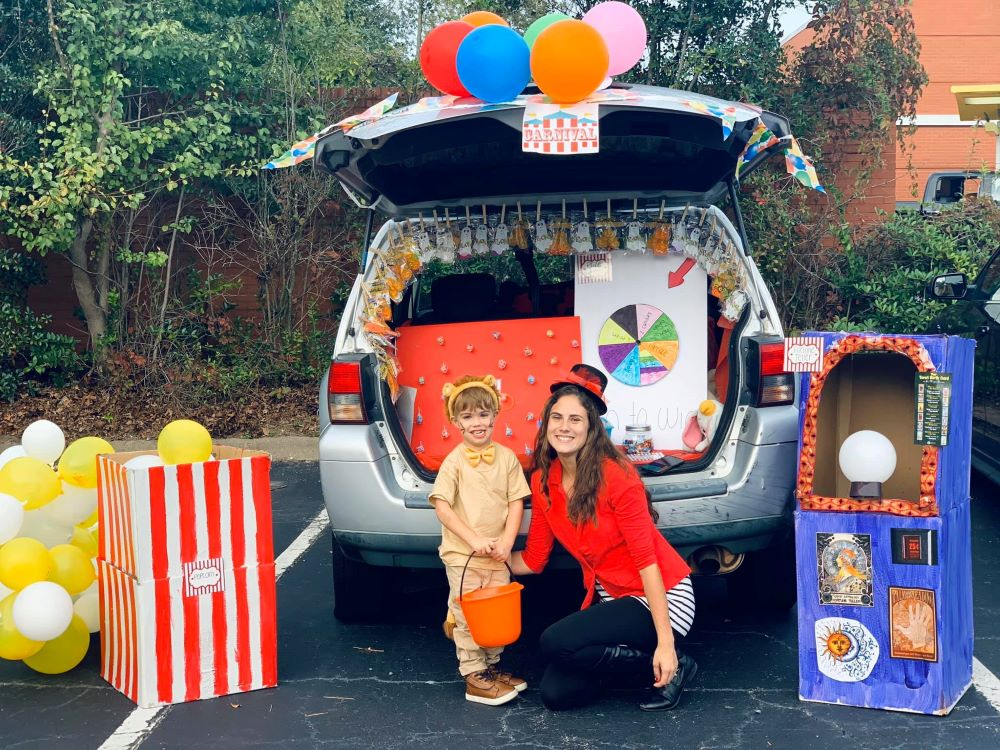 Pretty mom and her daughter wearing magician outfits while on the back of their car that they used as props for a school activity at a Preschool & Daycare Serving Hampton Roads, VA