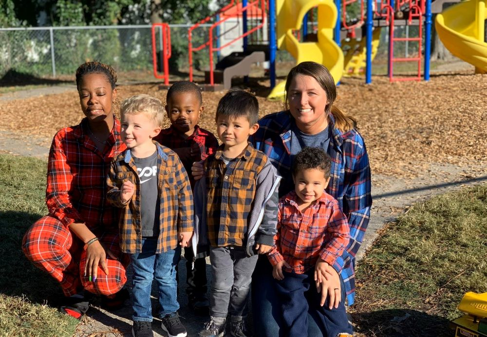 Happy teachers and preschool little kids wearing a farm attire enjoying at the playground at a Preschool & Daycare Serving Hampton Roads, VA