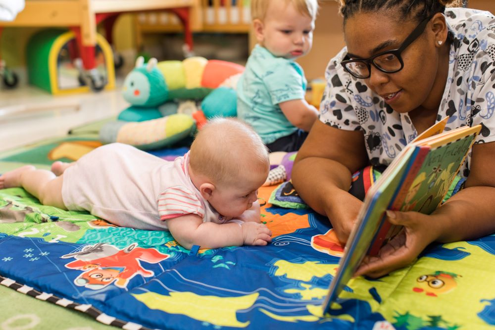 Teacher reading and storytelling to the babies at a Preschool & Daycare Serving Hampton Roads, VA