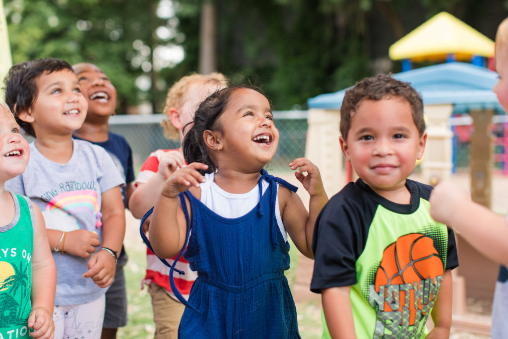 Happy group of diverse little you ones enjoying at the playground at a Preschool & Daycare Serving Hampton Roads, VA