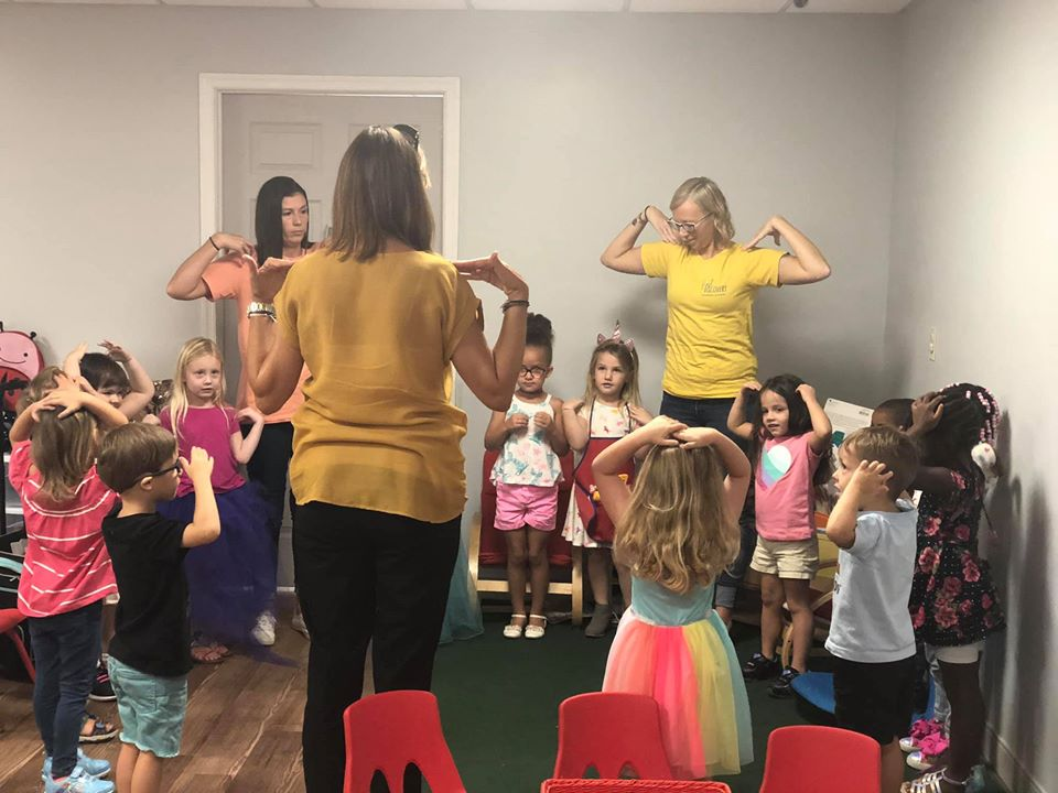 nursery children together with their teachers enjoying some school activities at a Preschool & Daycare Serving Hampton Roads, VA